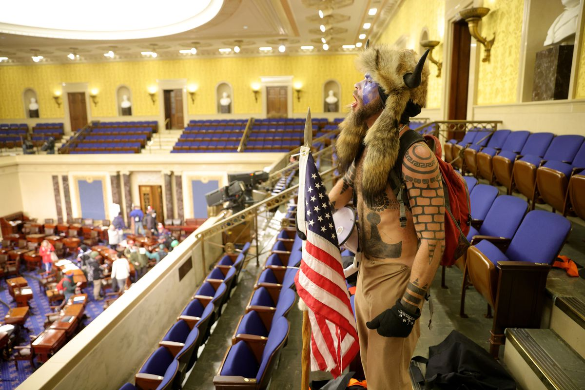 A protester yells inside the Senate Chamber on January 06, 2021 in Washington, DC. Congress held a joint session today to ratify President-elect Joe Biden's 306-232 Electoral College win over President Donald Trump.