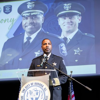 Keith Cross speaks during his induction ceremony as Aurora's new police chief on Aug. 11 at East Aurora High School.